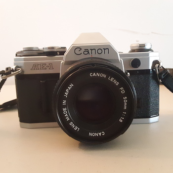 Rent Canon AE-1 35mm SLR Film Camera with FD 50mm 1.8 Lens