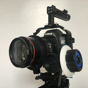 Rent Canon 5D DSLR Cage and Follow Focus System, with Top Handle, Cheese Plate, 15mm base plate, and 15mm 1' rod. (Camera not included)