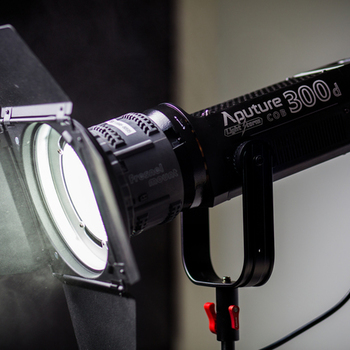 Rent Aputure 300D with Fresnel adapter & barn doors with gels (gold mount version)