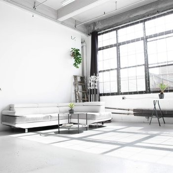 Rent Glowing All-White Loft with Wall of Windows
