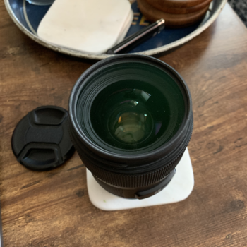 Rent Sigma 35mm/f1.4 Lens with Lens and Back Cover + Lens Hood