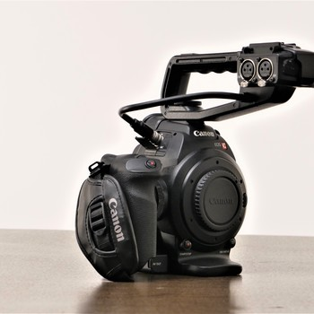 Rent Canon C100 with top handle, Battery and Power Supply/Charger
