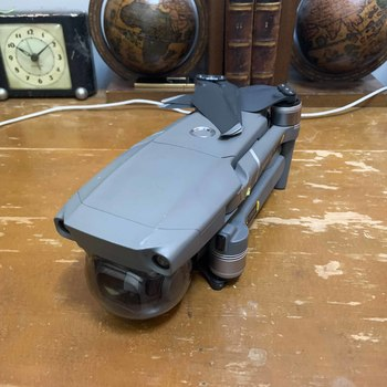Rent DJI Mavic 2 with extra battery, ND filters, blades, and carrying case.