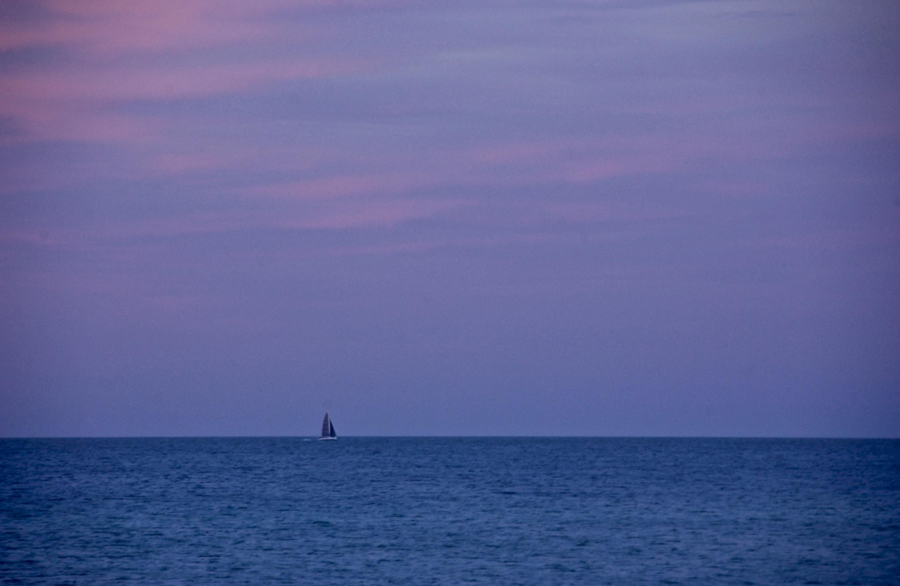 Heading for Port at Sunset; Edgartown, Martha's Vineyard, Massachusetts, USA