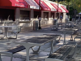 A photo of empty tables in front of the food stands across from Paley.