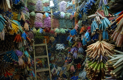 Bursts of myriad colors in a thread merchant's stall; Medina at Fez, Morocco, North Africa. December 2007.
