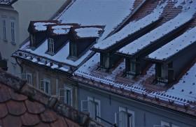 Snow on the roof tops; winter sunrise; Ljubljana, Slovenia. January 2015.