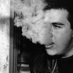 """Smoking"" Ryan Scott, 21, enjoys a late night cigarette on the front steps of his apartment building in Fairmount. Scott began smoking his freshman year in college. ""It was just something all my friends did,"" he said. Michael Potter, Basic Photography Fall 1999"