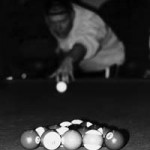 """Election Day, Nov. 7, 2000"" 9:30 p.m. A game of eight-ball occupies time on Election night at the fire house in King of Prussia. John Davis, Basic Photography Fall 2000"