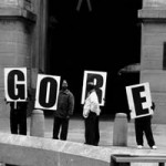 """Election Day, Nov. 7, 2000"" 4:35 p.m. Gore supporters gather at all entrances of City Hall with large signs. Delia Desai, Basic Photography Fall 2000"