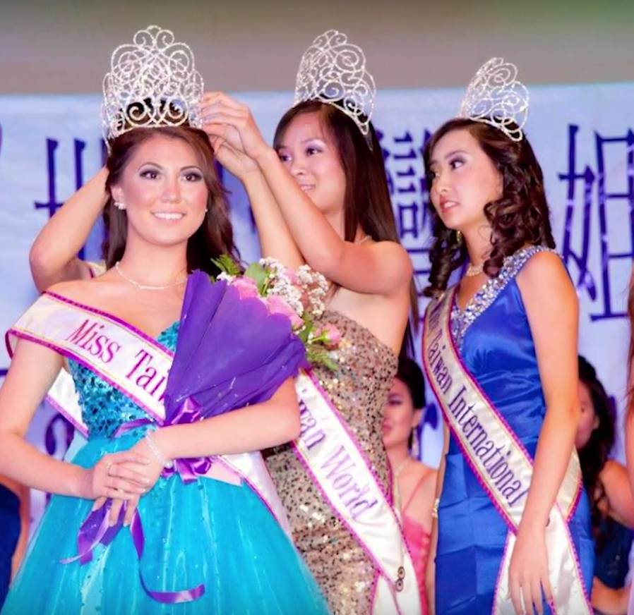 Pagent winner receiving sparkling crown on her head