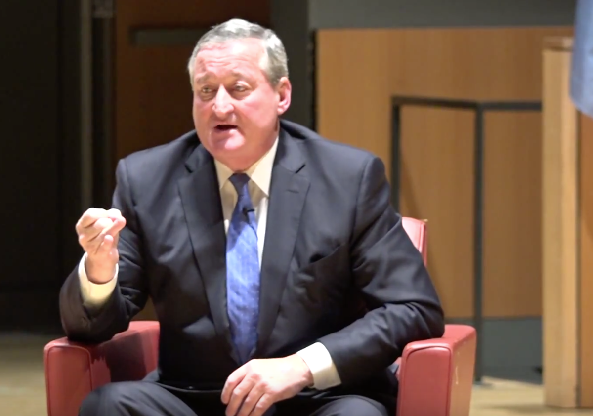 Jim Kenney in a black suit in a chair