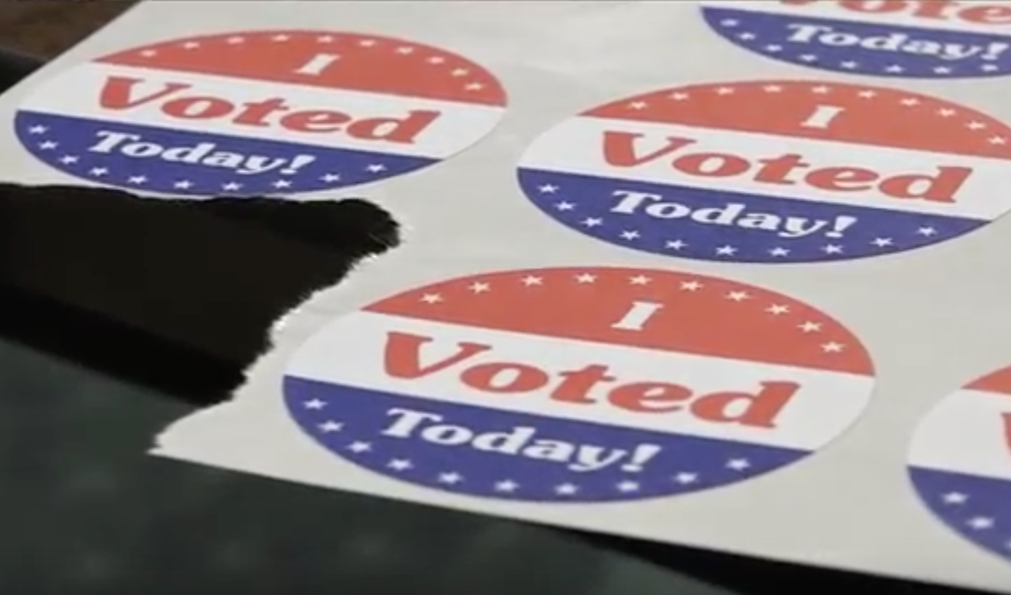 "Picture of a sheet of stickers that say, ""I voted today!"". The stickers have red, white, and blue colors."
