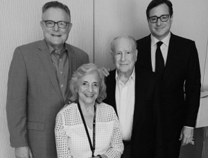 Lew Klein, center, with wife Janet, Dean David Boardman, and Temple Alum Bob Saget at the NATPE Conference.