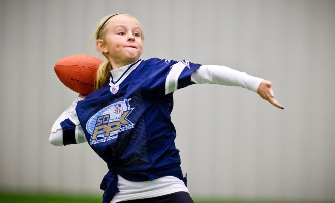 One of many competitors, this young lady attempts a pass to win a chance at making it to the National NFL PPK Final.