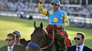 American Pharoah and Jockey: Victor Espinoza