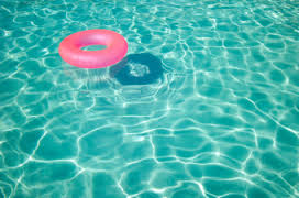 Two-year old found unconscious in pool, charges filed