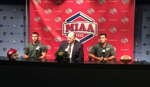 LB Justin Tomlinson (Left), Coach Denver Johnson (Middle), WR Michael Nelson (Right)