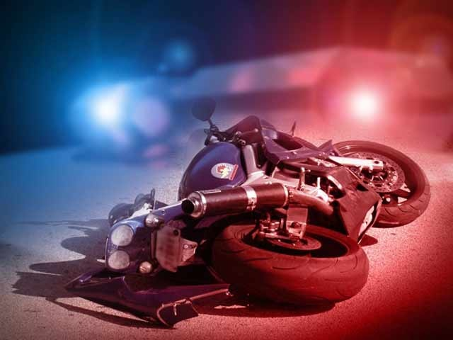 Motorcycle crash after contact with roadway debris