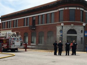 Photo by Miles Carter, on scene as smoke began to billow from the Bank 21 building on the Carrollton Square.