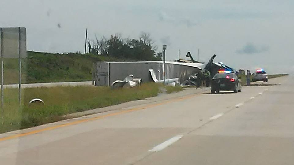 Semi overturns west of Mooresville after clipping combine