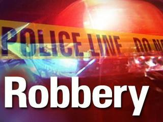 A pair of robberies are keeping Columbia detectives busy