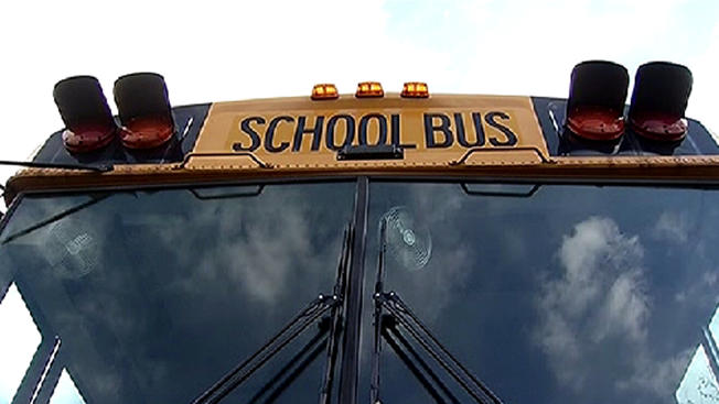 One in custody for suspicion of burning school bus