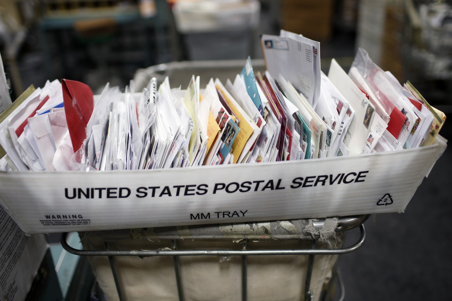 Postal worker pleads to pilfering mail at KC distribution center
