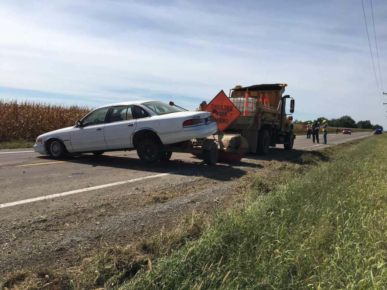 Traffic slowed after vehicle struck a MoDOT truck just west of Carrollton on MO-10