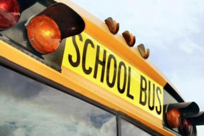 Several injured in school bus crash with minivan