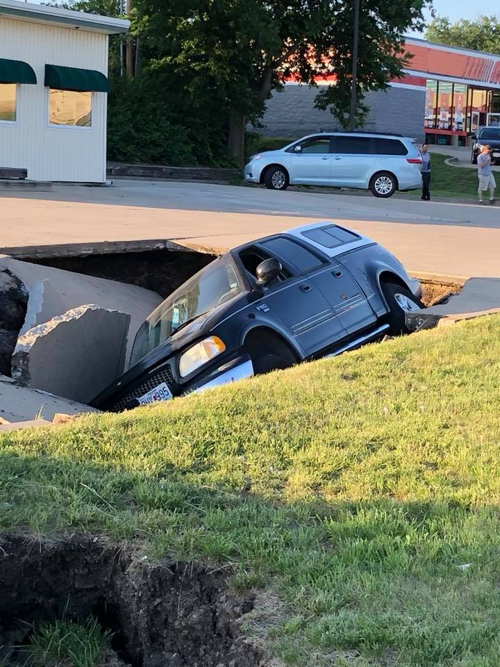 Sinkhole opens in Excelsior Springs, partially swallowing a car