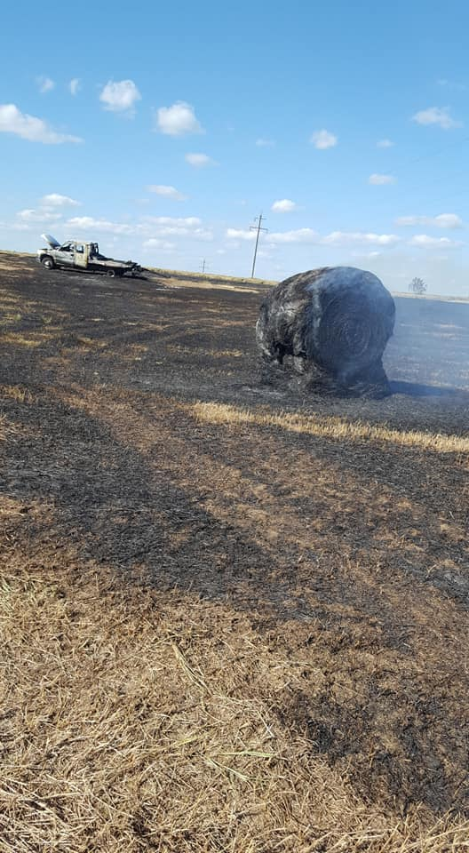 A pickup and several hay bales burned in Mercer County.