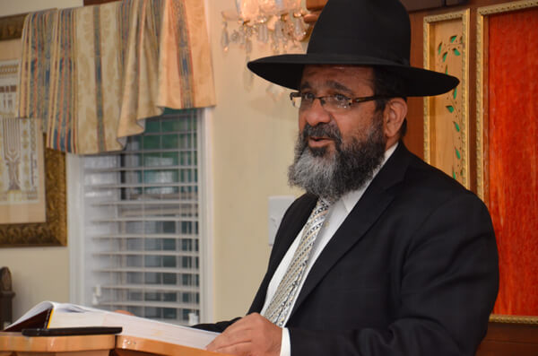 Rav Shmuel Kohshker man, Congregation Ner Hamizrach delivers a hesped for Rebbitzen Kotler