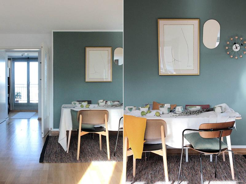 Wandfarbe in Dunkelgrün im Esszimmer.