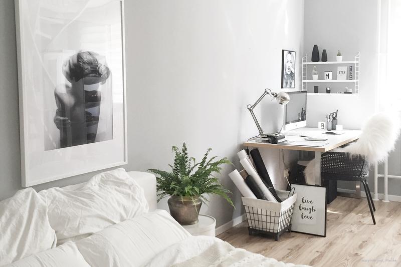 Skandinvisches Interieur kombiniert mit der Wandfarbe Grau.