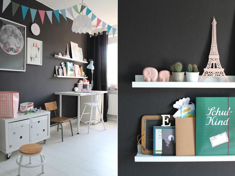 Kombination aus Wand in Dunkelgrau und hellen Pastelltönen.