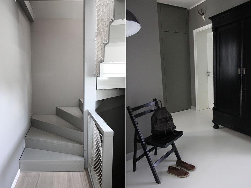 Ein Flur mit Wänden in Grau.