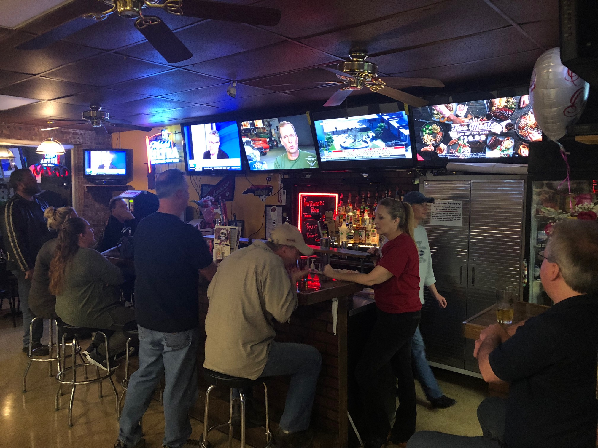 Customers from Aberdeen and Southern Pines enjoy drinks at the bar