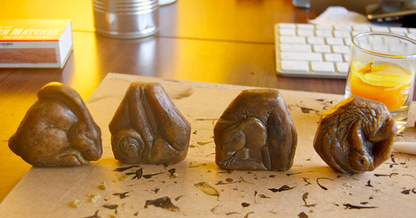 A few of Crystal's animal molds, perched deskside.