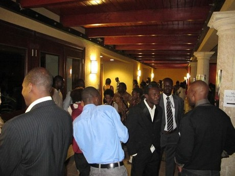 A pre-screening crowd mingles at The Hotel Karibe.