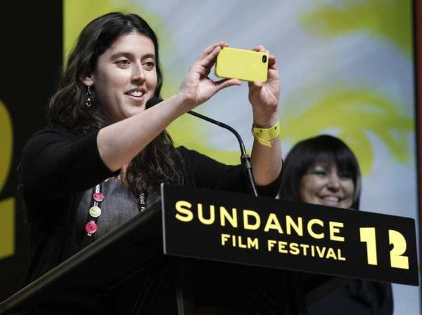 Alison Klayman accepts her Special Jury Prize, and takes a moment to snap a photo of the audience.