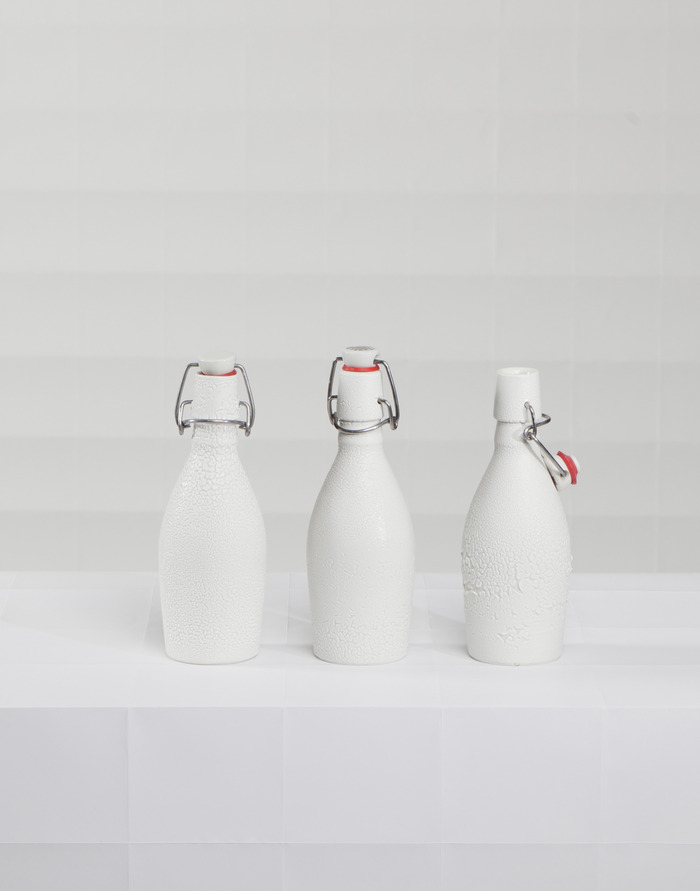 The Level 5 Reward: A High-fired Porcelain bottle covered in a 'Crawling' glaze. These bottles are fitted with a swing-arm top and rubber gasket for a water-tight seal.