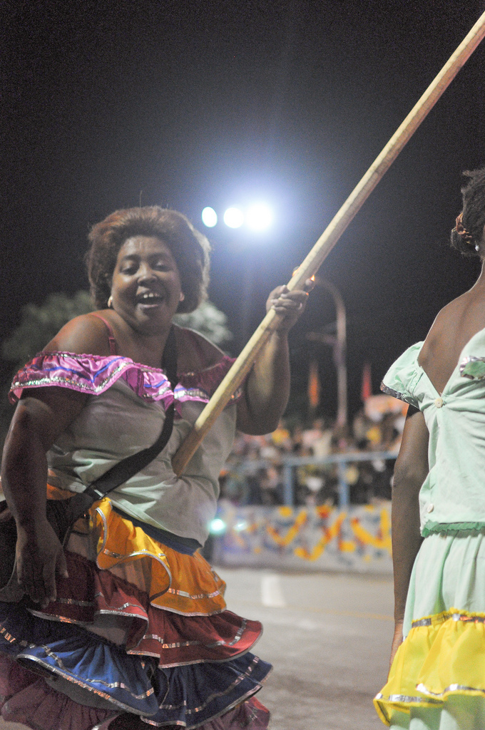 A woman has donned her best costume and smile for Carnival, also known as Mamarrachos, which overwhelms Santiago de Cuba towards the end of July to celebrate life, Afro-Cuban culture, and Fidel Castro's 26th of July Movement.