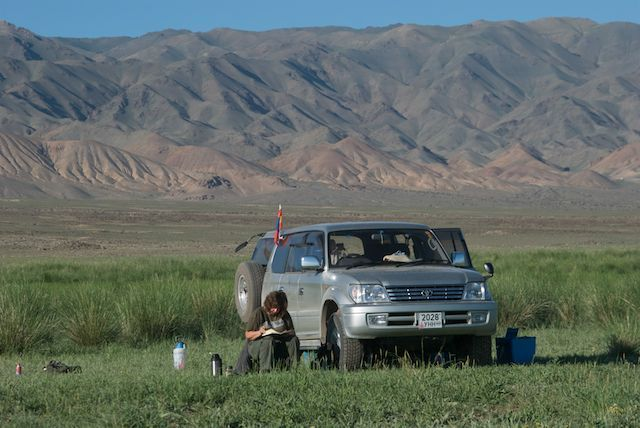 Susan Fox painting a watercolor study at Orog Nuur, a remote Gobi lake, July 2010