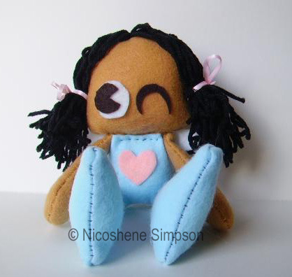 Handsewn plush doll in a different style.