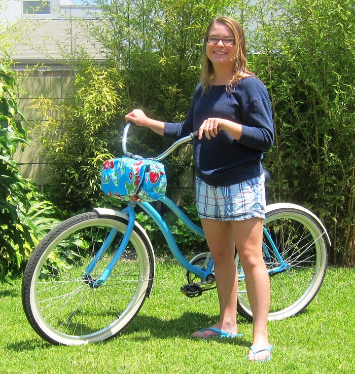 Annie with a bike purse attached to her beach cruiser.