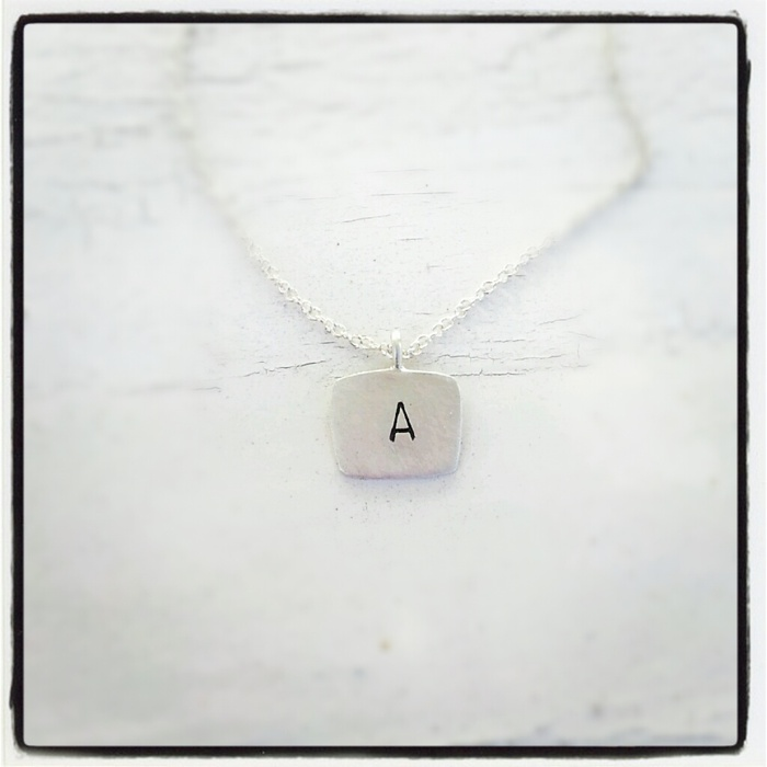 Hand carved & hand stamped sterling silver letter necklace. Pledge at $35, $850 Level