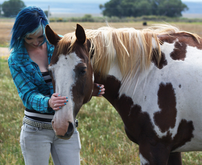 The Director, Chelsea Christer with her horse.
