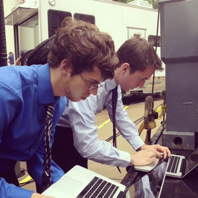Ryan and Kevin furiously typing up the latest report during court recess.