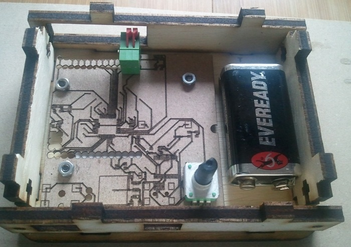 Inside the box layout with a cardboard mockup of the latest board (9v not included)
